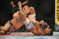 """UFC wrestling <a href=""""http://www.shutterstock.com/gallery-1966235p1.html?cr=00&pl=edit-00"""">A.RICARDO</a> / <a href=""""http://www.shutterstock.com/editorial?cr=00&pl=edit-00"""">Shutterstock.com</a>"""