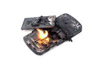 Phone on fire, photo via Shutterstock