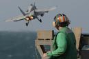 Aircraft carrier take off photo via Shutterstock