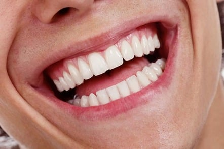mAN SMILES INTO CAMERA, pHOTO BY sHUTTERSTOCK