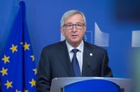 Jean-Claude Juncker speaking in front of EU flag