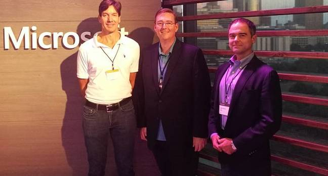 Microsoft's Mark Russinovich with customer Daryll Fogal and Docker COO Scott Johnston