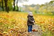 Crying baby in autumn. Photo by shutterstock