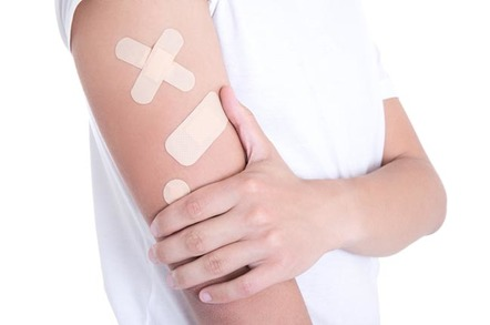 plasters cover arm. photo by shutterstock
