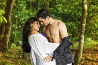 """Couple kissing - shirtless man with woman - """"romance novel cover"""" style. Photo by shutterstock"""