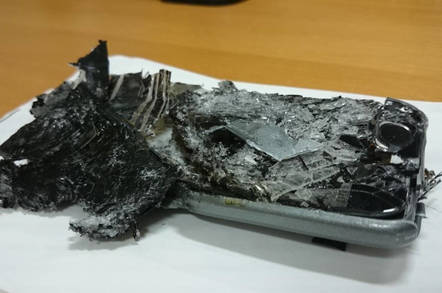 A phone found crushed within a QANTAS business class seat