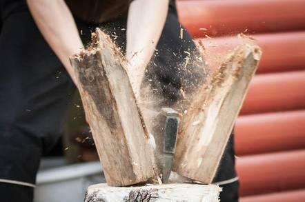 axe splits wood