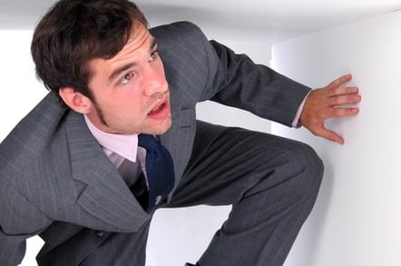 man in suit is trapped in a box, Photo by Shutterstock