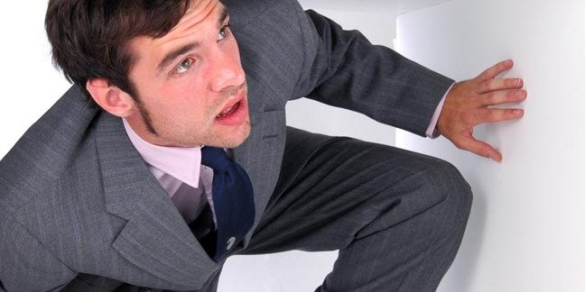 man in suit is trapped in a box, Photoby Shutterstock