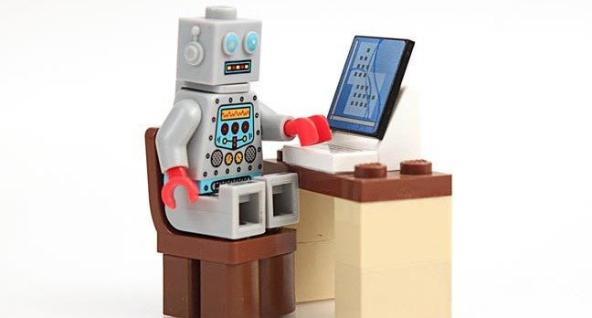 lego robot sits at lego pc. Photo by Shutterstock -EDITORIAL USE ONLY MUST CREDI cj macer