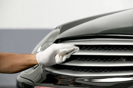 Car polishing photo via Shutterstock