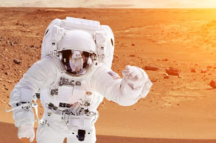 Astronaut on mars . Photo by shutterstock