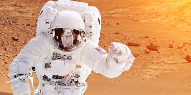 Astronaut on mars . Photo by shutterstock