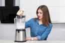 woman uses blender. Photo by shutterstock