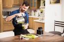man uses blender. Photo by shutterstock