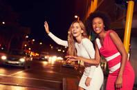 Two women hailing a ride