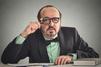Skeptical manager image via Shutterstock