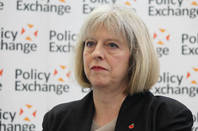 theresa may https://www.flickr.com/photos/policyexchange/10725847516/in/photostream/ licensed under https://creativecommons.org/licenses/by/2.0/