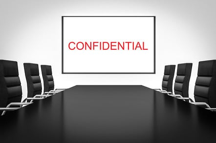 Confidential on white screen in boardroom. Photo by Shutterstock