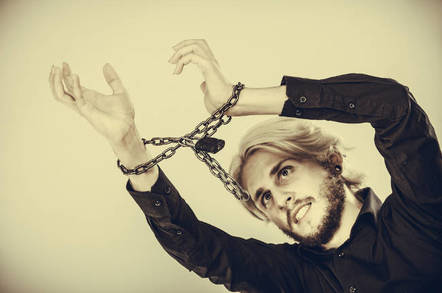 A man with his hands chained up