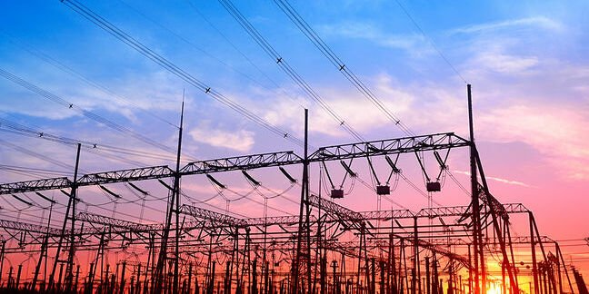 High voltage power grid, in the sunset. Photo by SHutterstock