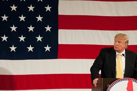 Trump with flag photo via Shutterstock