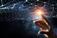 Conceptual illiustration of fifth/sixth dimension. Finger presses light net. pHOTO BY shUTTERSTOCK