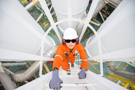 Oil refinery - engineer checks fuel mix. Photo by Shutterstock