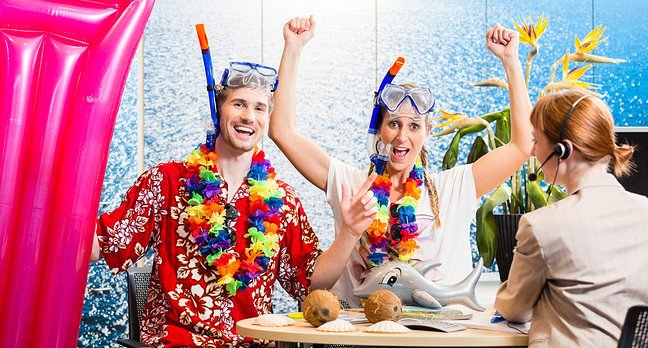Couple in snorkelling gear at the travel agents... Comedy snap. Photo by Shutterstock