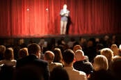 Standup comedian faces the crowd. Photo by shutterstock
