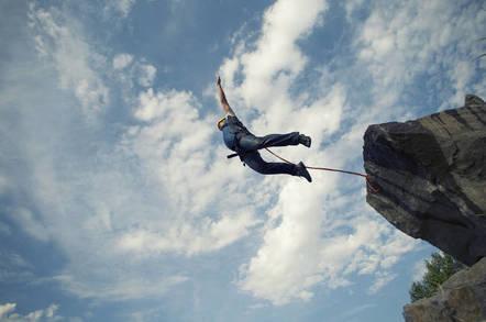 A man jumping off a cliff