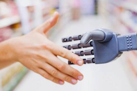 A robot and person shaking hands