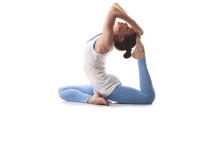 Woman does a yoga stretch. Photo by Shutterstock