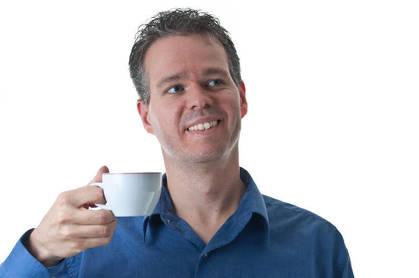 A man holding a mug of coffee