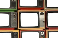 Wall of TV screens photo via Shutterstock