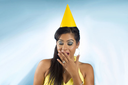 Woman looks bored wearing birthday hat. Photo by Shutterstock