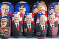 MOSCOW, RUSSIA, JANUARY 2017: Russian traditional toy - Matryoshka with a portrait of Putin and Trump. showcase souvenir kiosk Editorial credit: dimbar76 / Shutterstock, Inc.