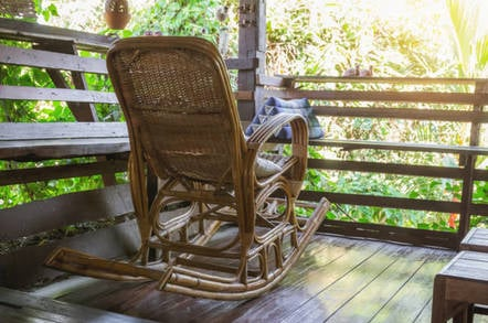 Rocking chair on porch. Photo  By Tapui/shutterstock