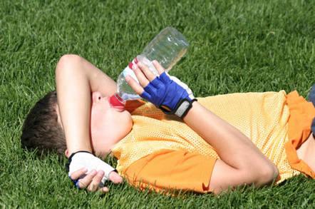 Tired football kid. Photo by Matt Ragen/Shutterstock