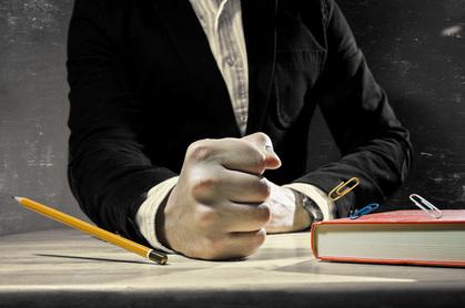 Punching desk photo via Shutterstock