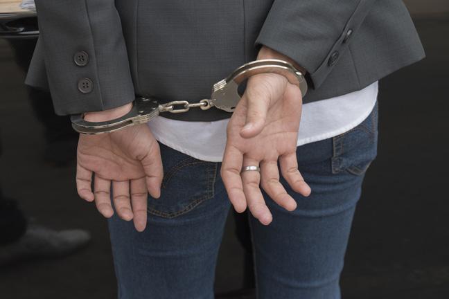 Handcuffed photo about Shutterstock