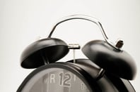 Alarm clock photo via Shutterstock