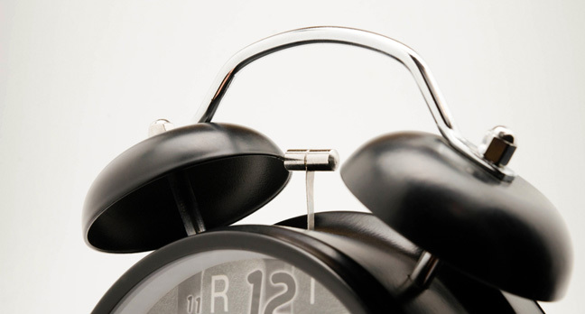 Alarm clock photo via Shutterstock