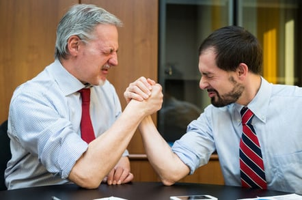 Arm wrestling photo via Shutterstock