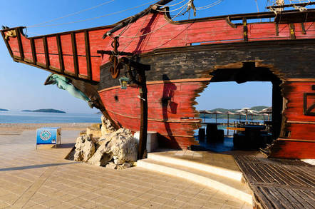 Pirate ship in Croatia with a hole blown through it. For editorial use only. Photo by shutteretsock/s-mart