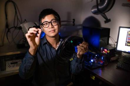 Graduate student Seongjun Park holds an example of a new flexible fiber
