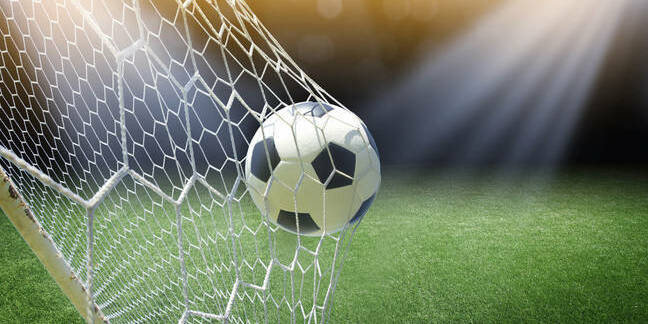 Football goes into the net/ photo by shutterstock