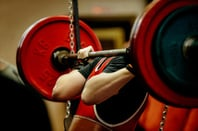 Weight lifter photo via Shutterstock