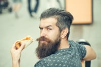 Hipster pizza guy photo via Shutterstock