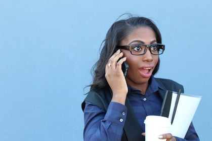 Woman with shocked expression answers cellphone. photo by Shutterstock
